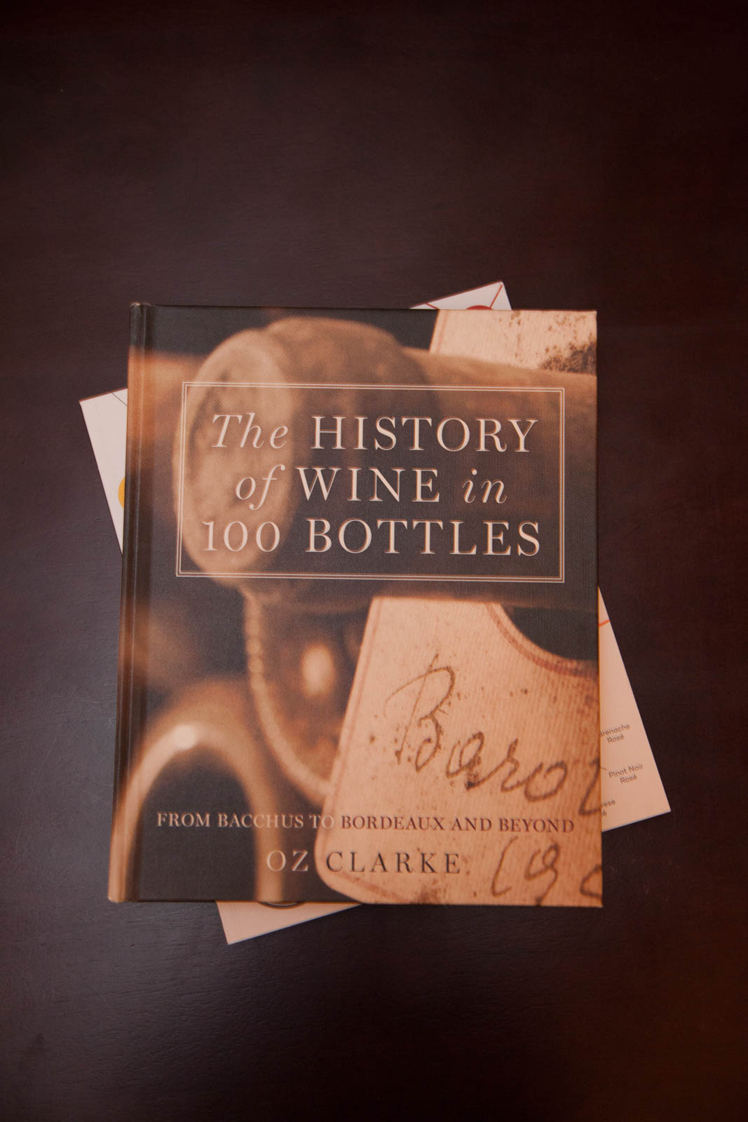 """The History of Wine in 100 Bottles"" by Oz Clarke"