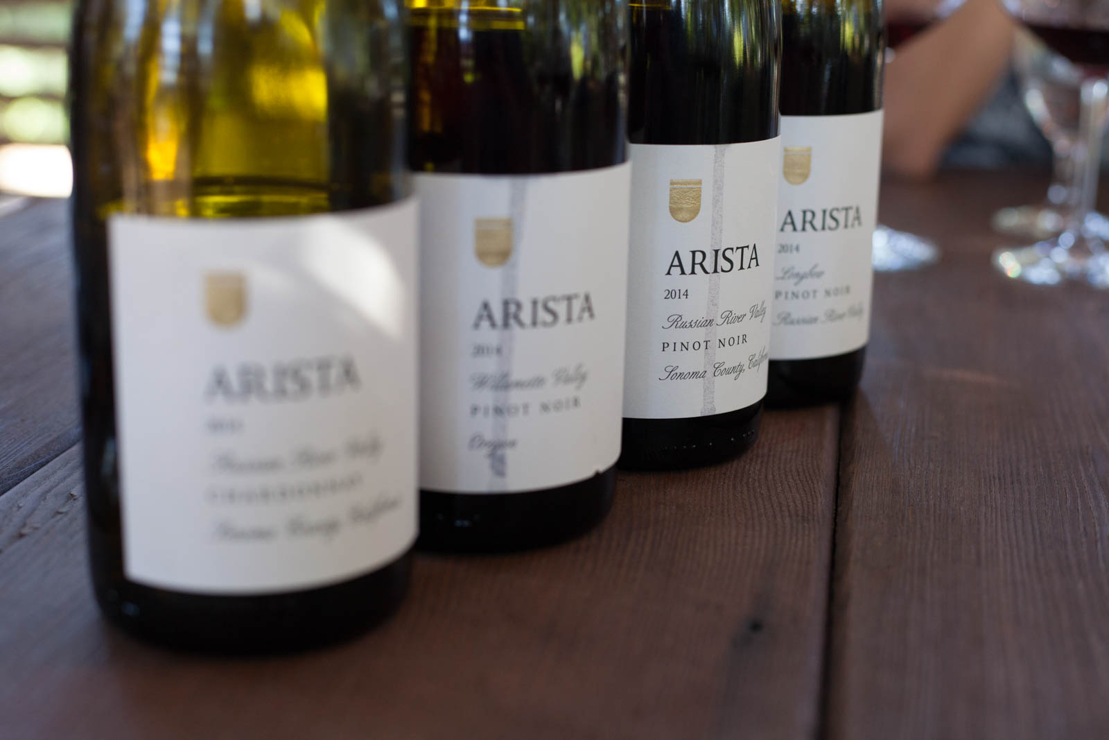 Bottles of wine at a wine tasting at Arista Winery. ©Kevin Day / Opening a Bottle
