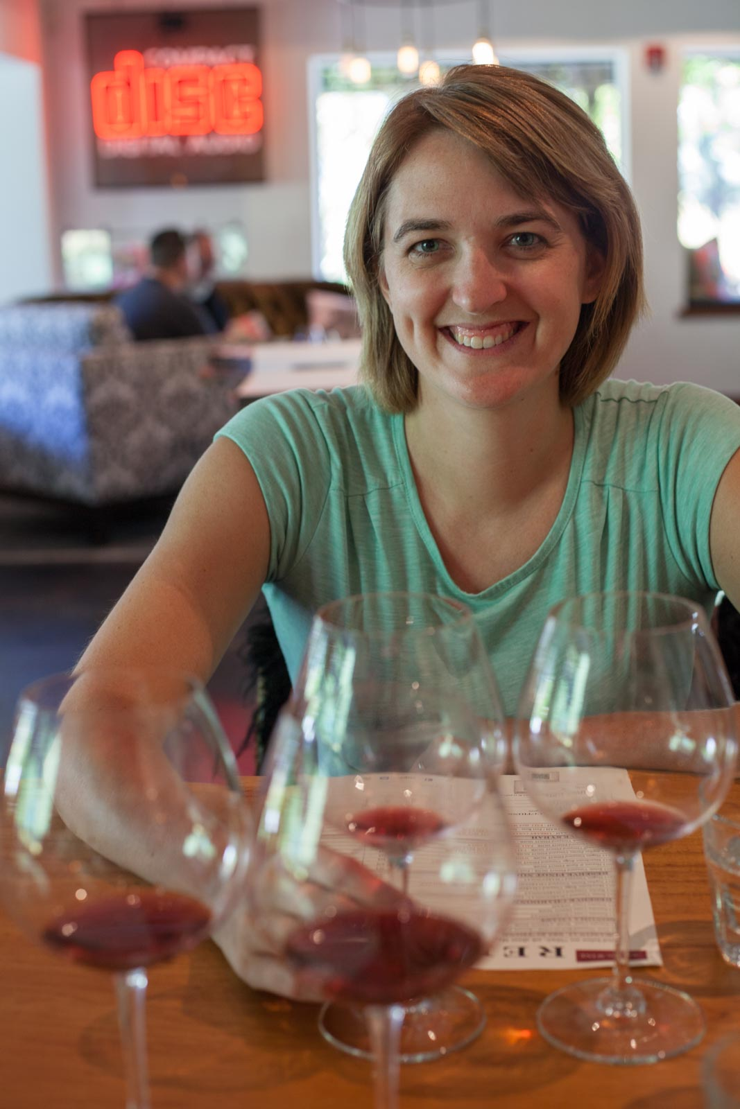Hailey sampling Red Car's Pinot Noir. ©Kevin Day / Opening a Bottle