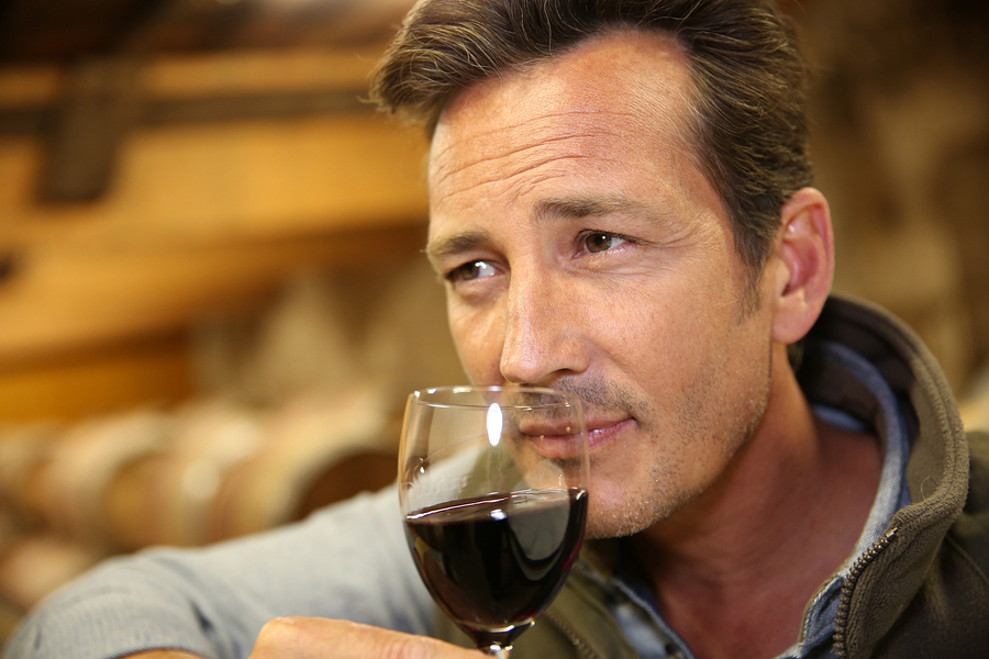 """Winemaker tasting red wine in cellar"" says the stock photo caption. I like ""Handsome model sniffs wine from a really tiny glass."""