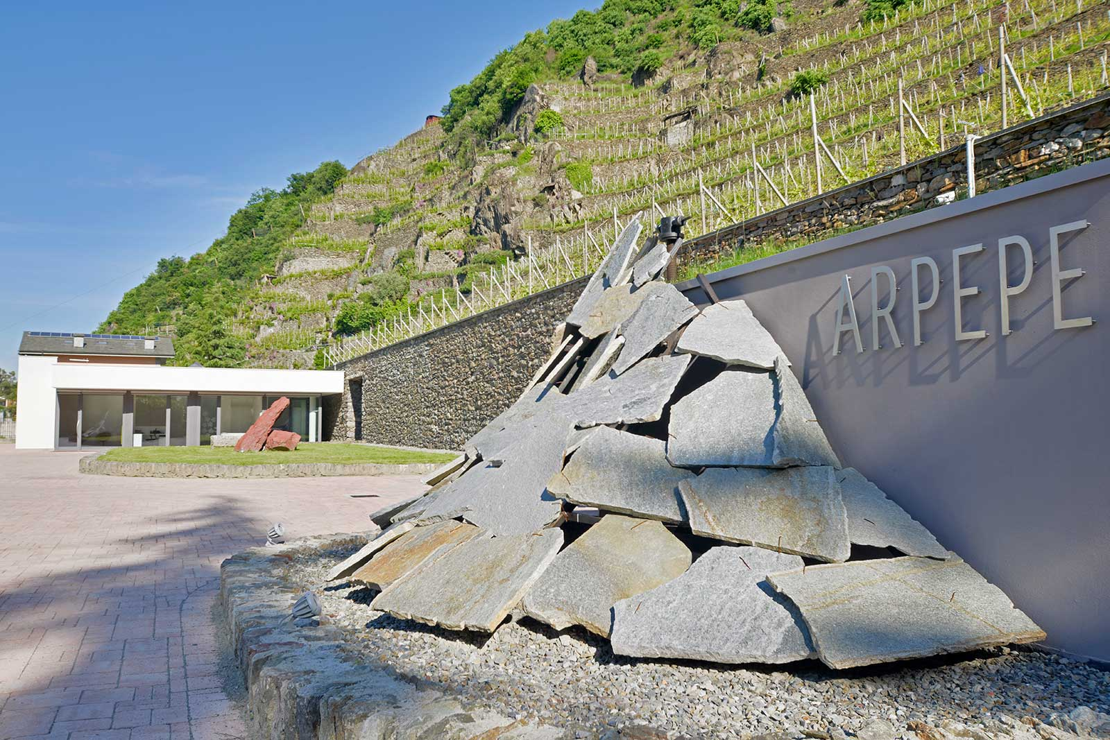 "The entrance to ARPEPE's winery beneath the vineyards that go into the Grumello ""Rocca de Piro"" Valtellina Superiore Riserva. ©ARPEPE"