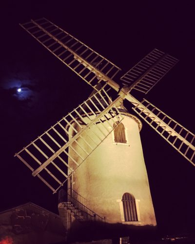The windmill of Moulin-à-Vent under a waxing moon at night. ©Kevin Day/Opening a Bottle