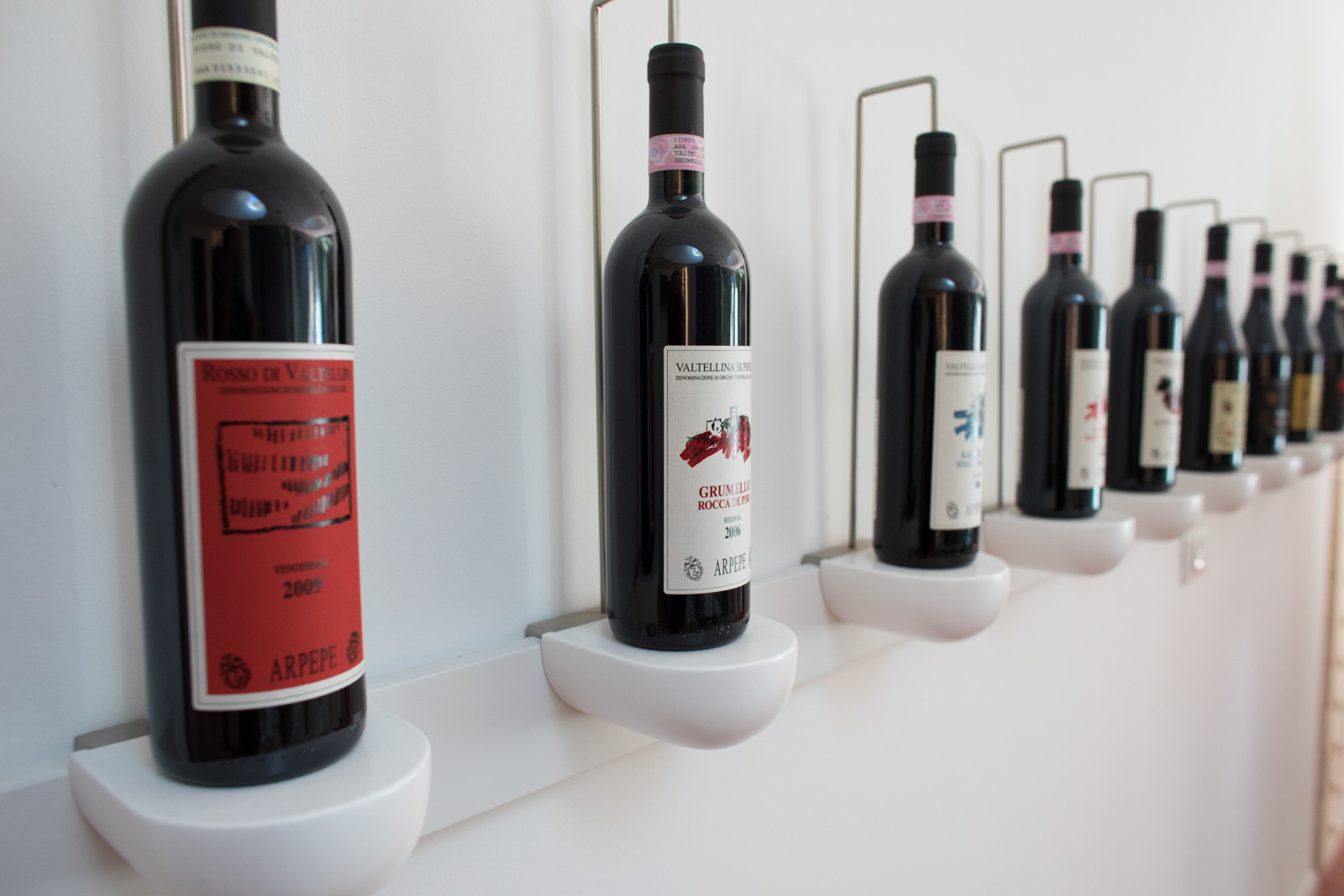 Bottles on display in the ARPEPE tasting room. ©Kevin Day/Opening a Bottle