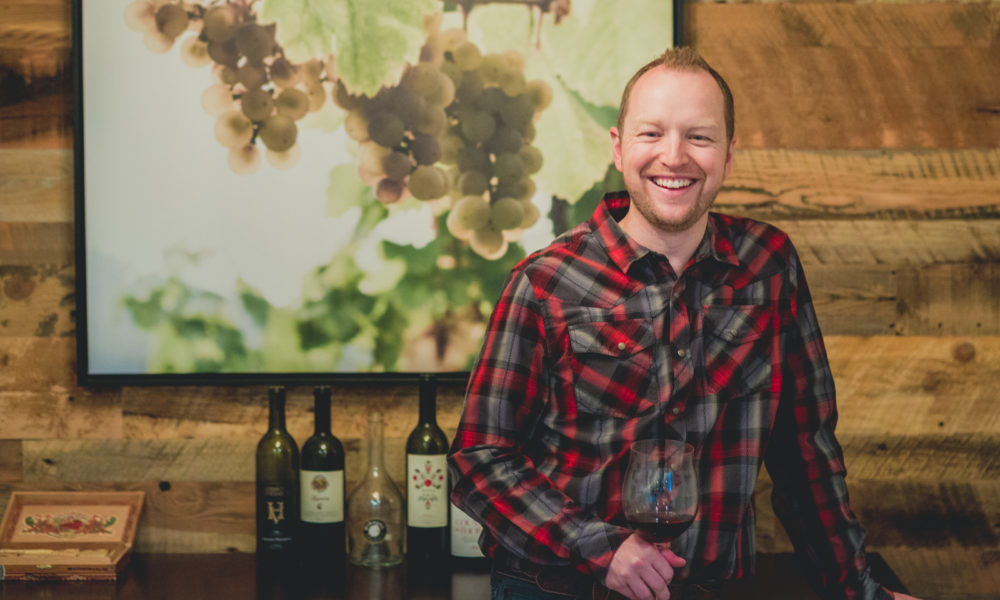"""Kevin Day, Founder of Opening a Bottle, in his """"wine cellar"""". Image by: http://www.BrianKraft.com"""