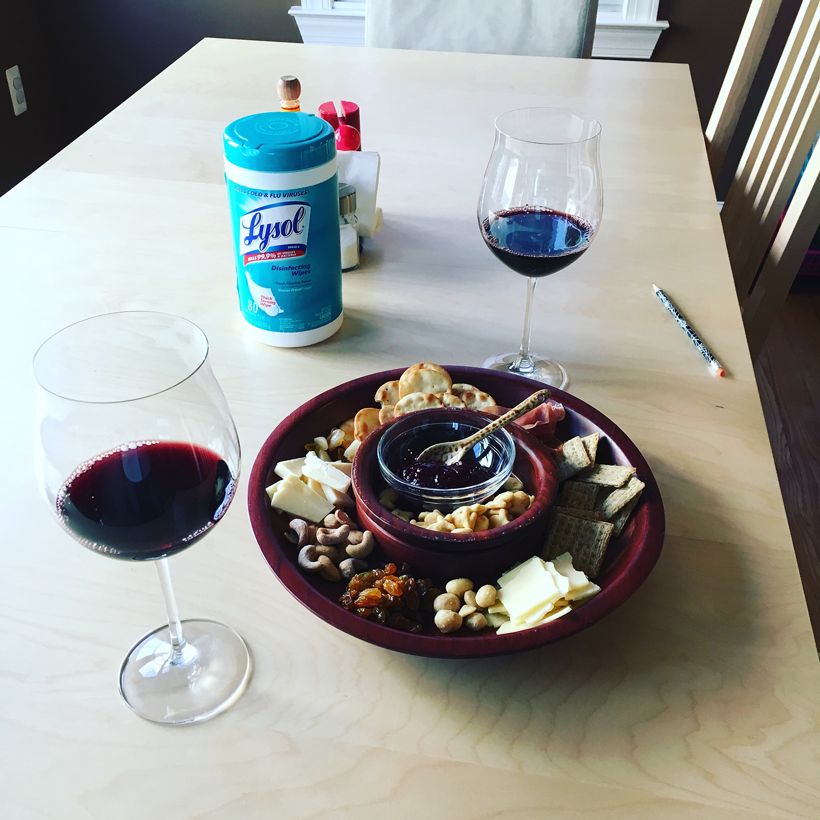 Our new reality: cheese plates, wine and Lysol wipes to keep the house germ free.