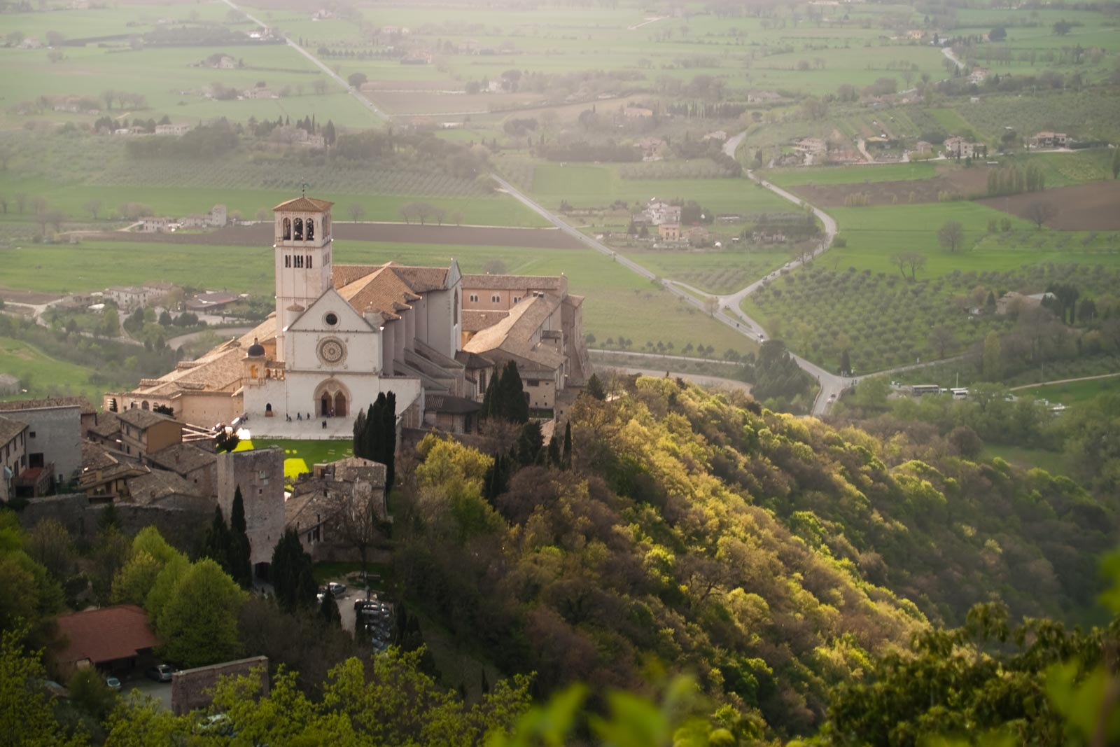 The Cathedral of St. Francis in the beautiful city of Assisi, one of the many cultural delights of Umbria in central Italy. When I asked for a local wine here, they brought a glass of Montefalco Sagrantino. ©Hailey Day/Opening a Bottle