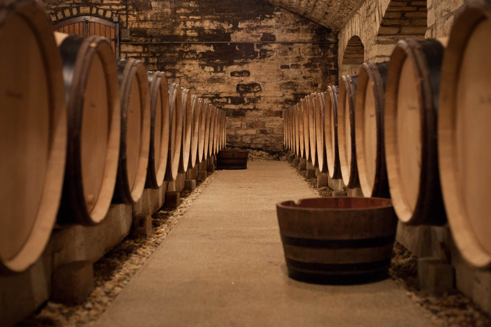 Unfathomable riches lie within these barrels: the 2016 vintage of Echézeaux, Grands Echézeaux and Corton. In typical vintages, the barrels would be stacked in twos, but not with 2016. Frost and hail kept yields very small.©Kevin Day / Opening a Bottle