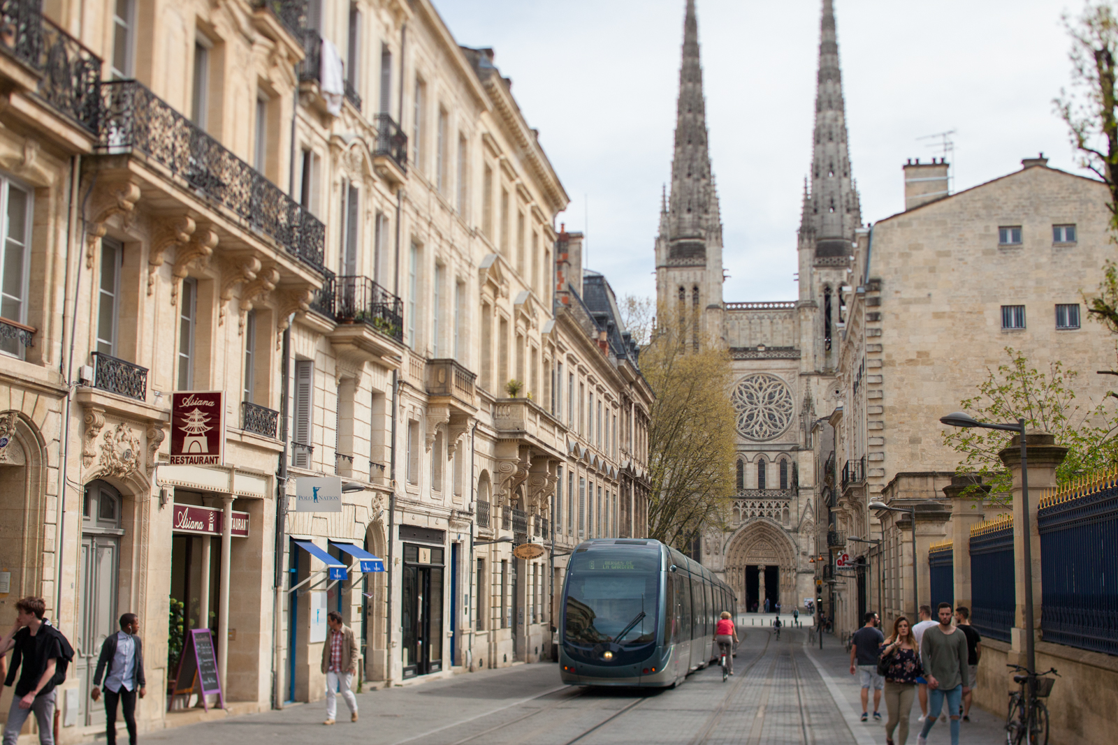 One of the efficient light-rail trains ambles up Rue Vital Carles with Cathédral Saint-André de Bordeaux in the distance. ©Kevin Day / Opening a Bottle