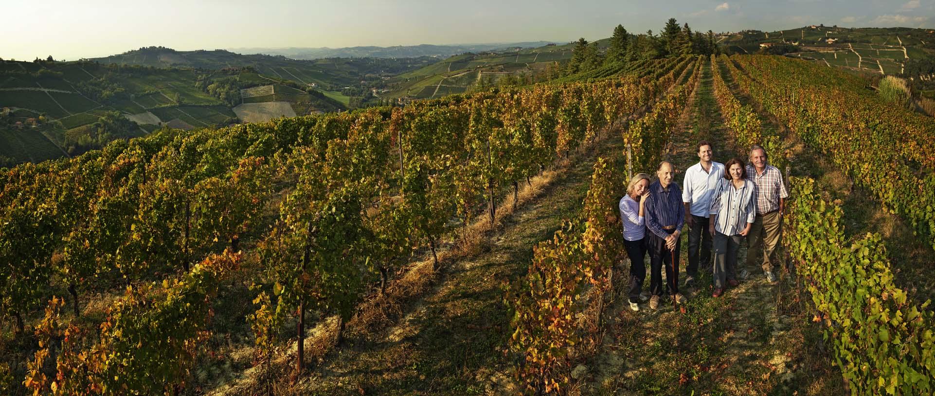 The Colla family stands in the Bricco del Drago vineyard. ©Poderi Colla