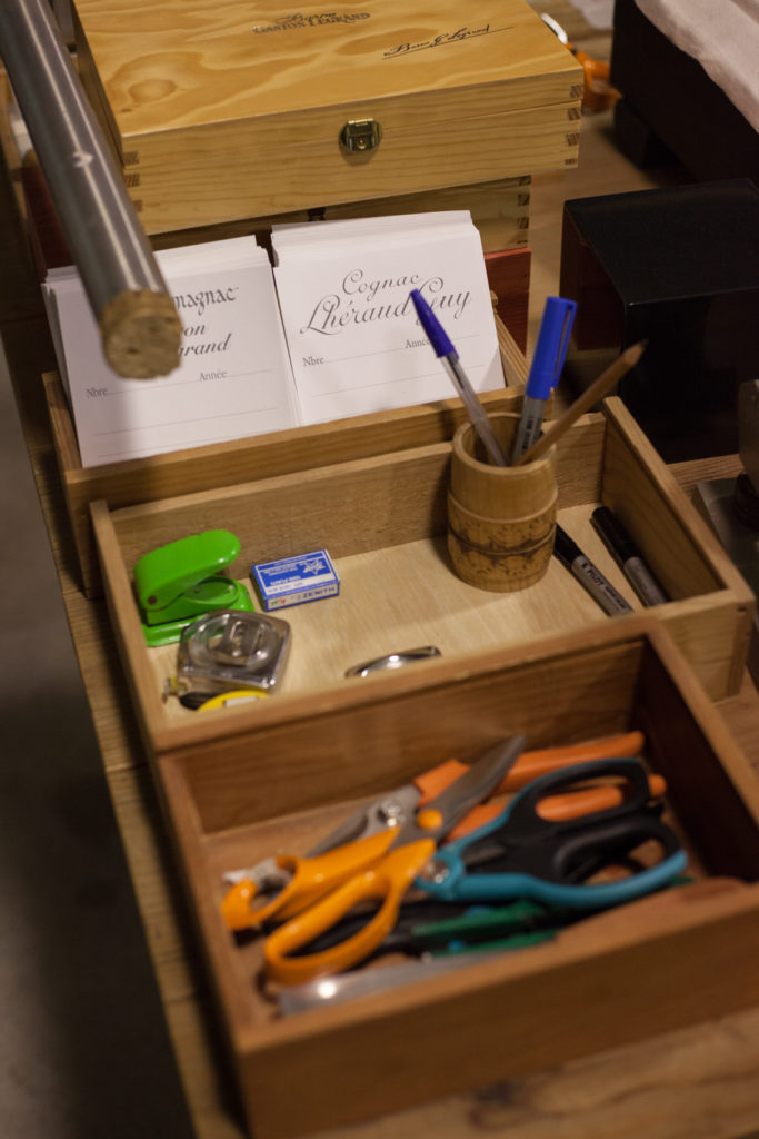 Tools of the labeling trade at Cognac Lhéraud. ©Kevin Day/Opening a Bottle