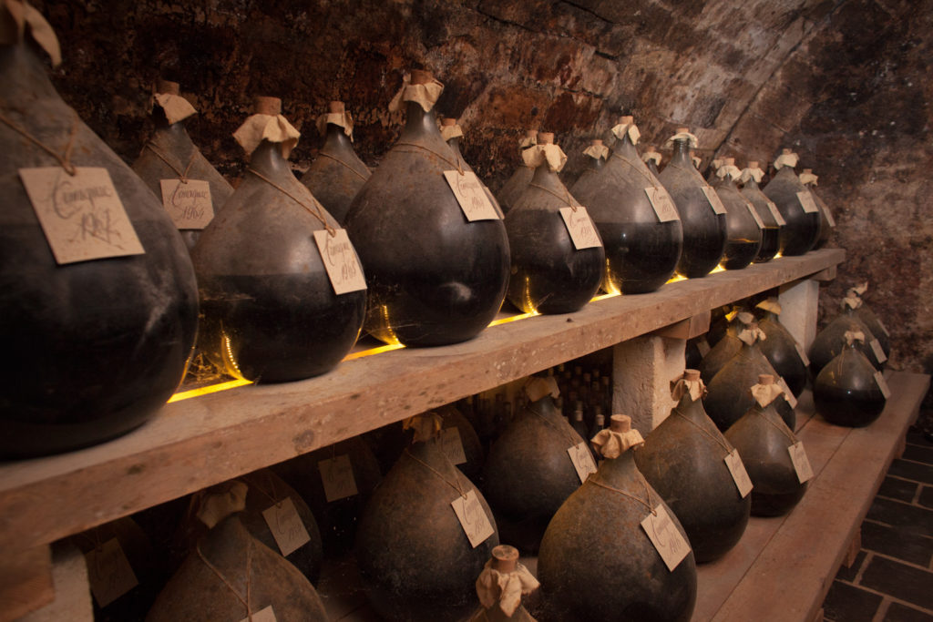 Old vintages of Cognac and Armagnac, some dating well over 100 years, line the cellar at Cognac Lhéraud. ©Kevin Day/Opening a Bottle