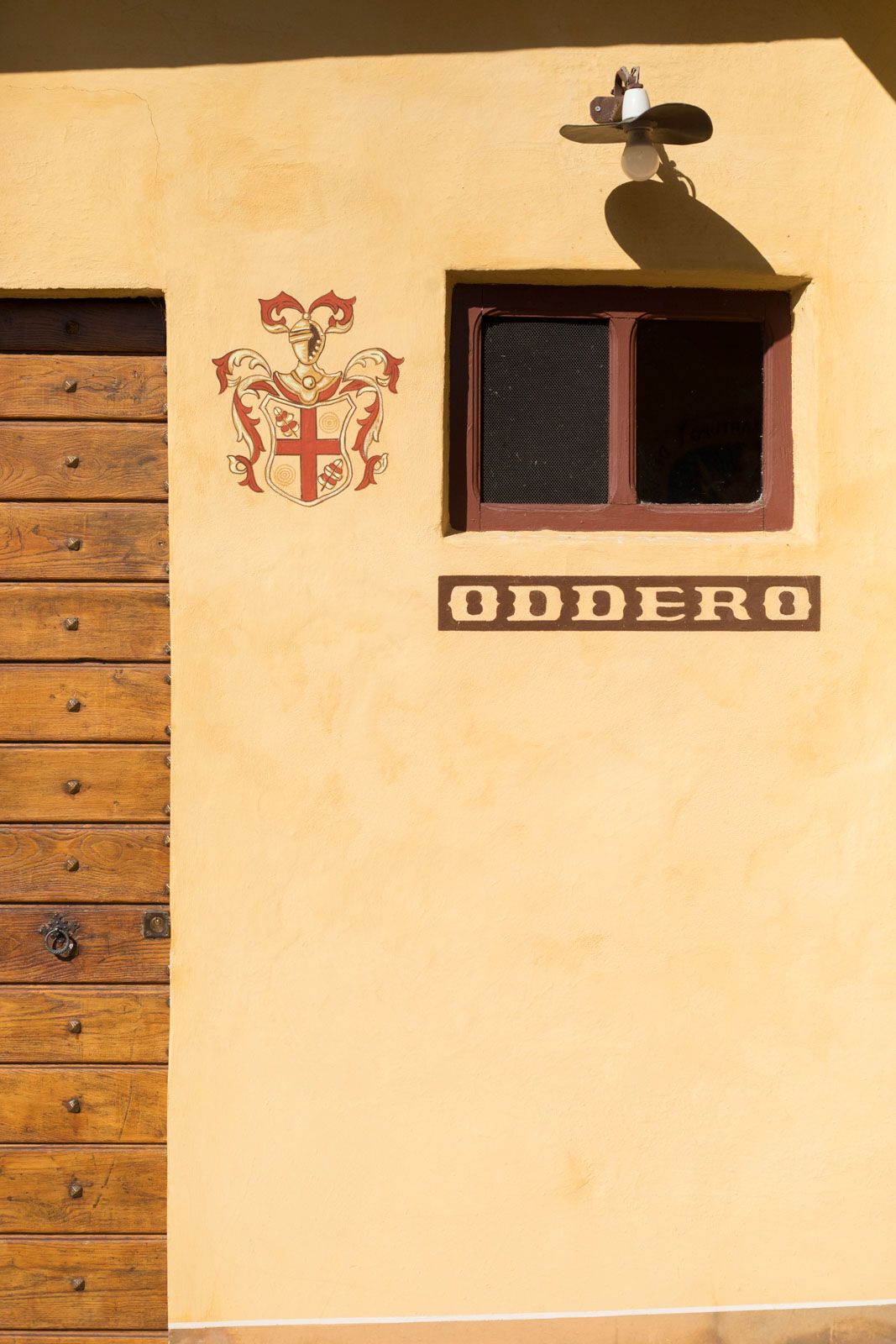The classic crest of Oddero at the entrance to the cellar. ©Kevin Day/Opening a Bottle