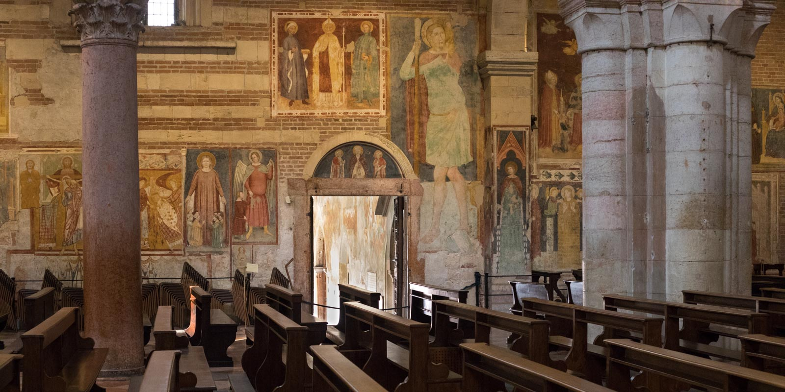 The biblical graphic novel walls of San Zeno's nave. ©Kevin Day/Opening a Bottle