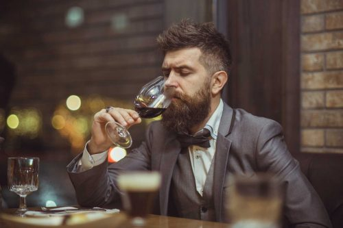 "This is what stock photographers think of wine drinkers. Note: I think that is the same hipster model in the featured photo above: ""Beer drinking is mirthful! Wine is deathly serious."""