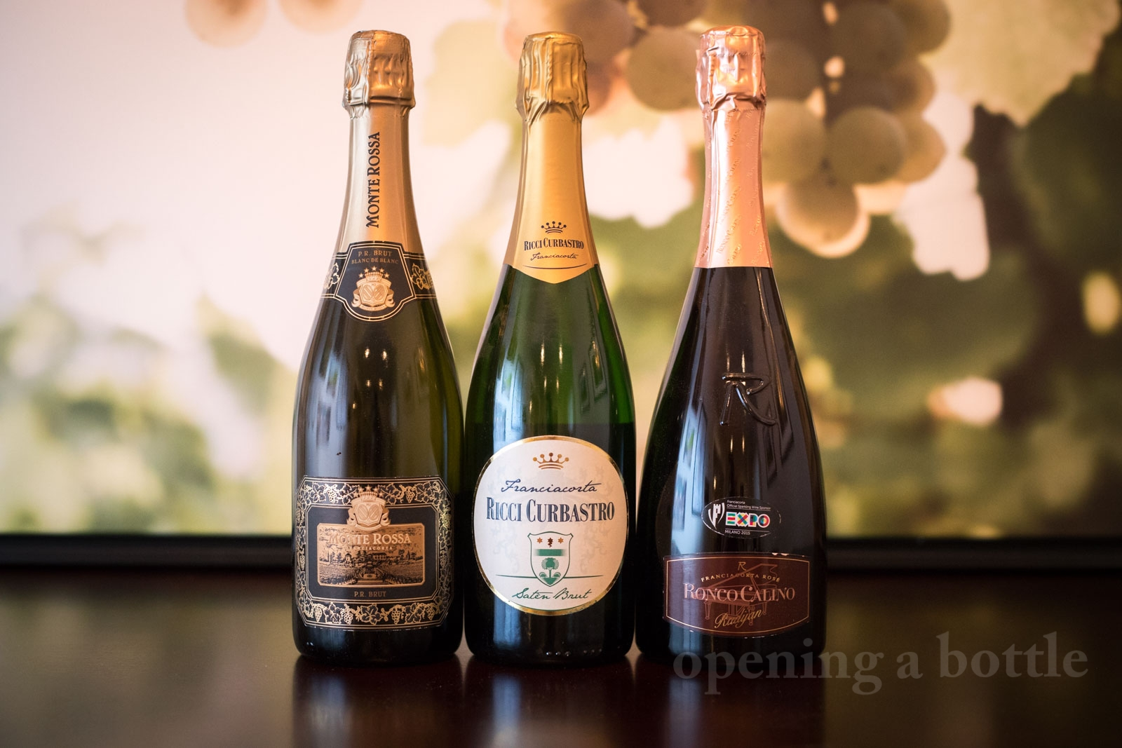 Three wines from Franciacorta: a Blanc de Blanc, Saten and Rosé. ©Kevin Day/Opening a Bottle