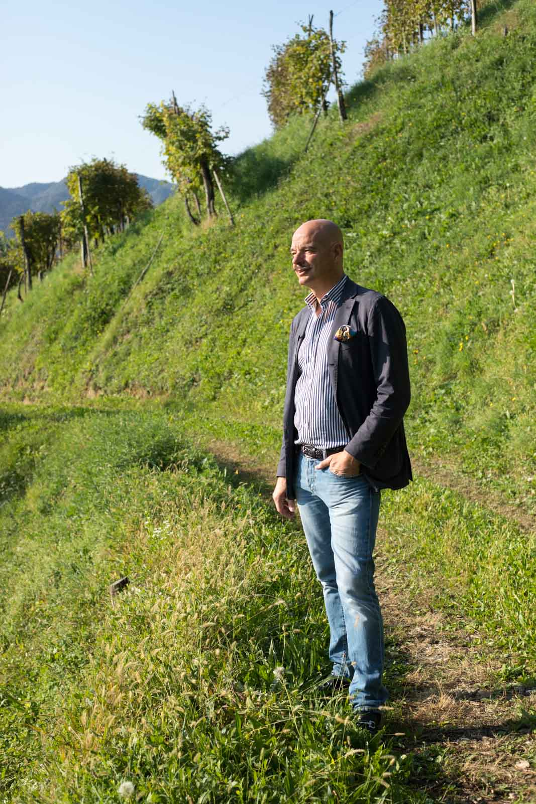 Gianluca Bisol, proprietor of Bisol, stands in the Rive di Campea vineyard near Valdobbiadene. ©Kevin Day/Opening a Bottle
