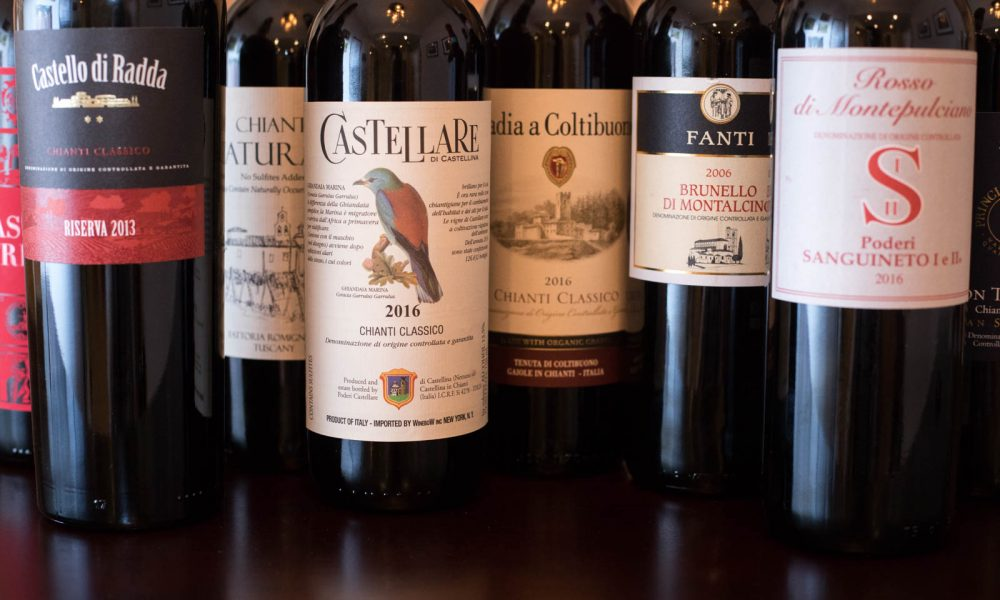 Wine bottles of Tuscany's various Sangiovese wines. ©Kevin Day/Opening a Bottle