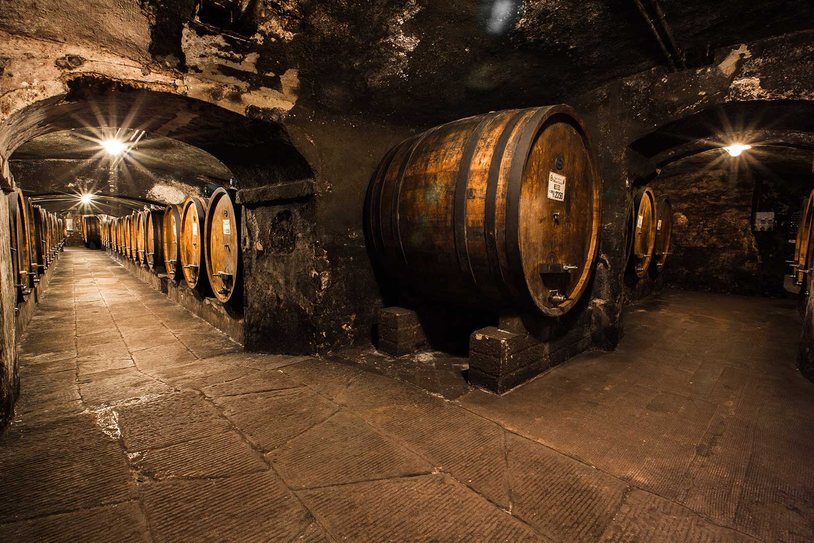 The ancient cellar at Badia a Coltibuono. Oak aging — whether in large casks or small barrels — has a major influence on the final wine, but the choice is ultimately up to the producer. ©Badia a Coltibuono