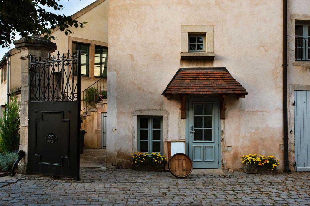 The modest facade of Domaine Dujac — no gilded archways or million-dollar tasting rooms here. ©Alexandra Karosis