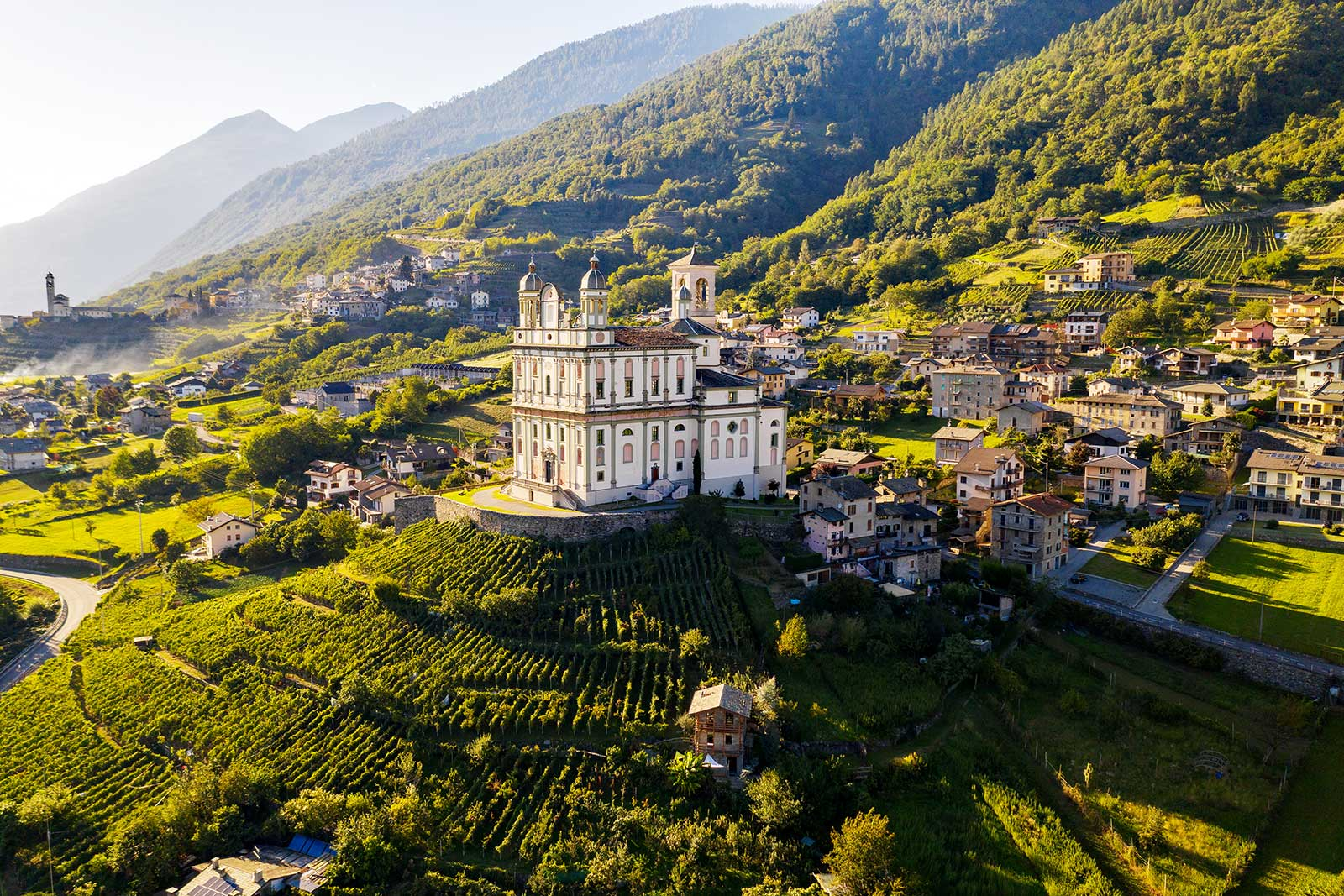 Chiesa della Santa Casa della Madonna Nera di Loreto crowns the vineyards of Valtellina in northern Lombardy, Italy.